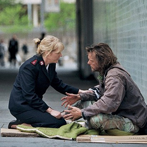 Salvation Army officer assisting homeless man