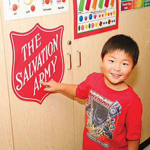 The Salvation Army smiling child with shield